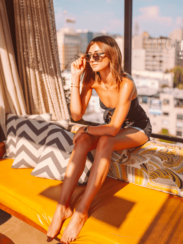 a woman sitting under a cabana